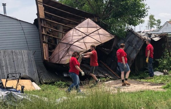 Volunteers with Churches of Christ Disaster Response Team work to clean up following the tornado.
