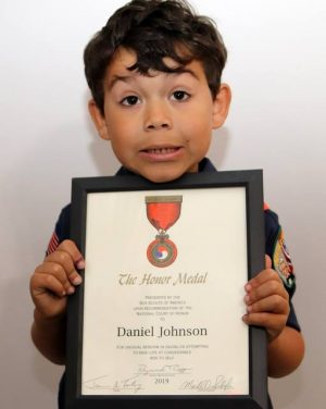 Daniel Johnson with honor presented by the Boy Scouts.