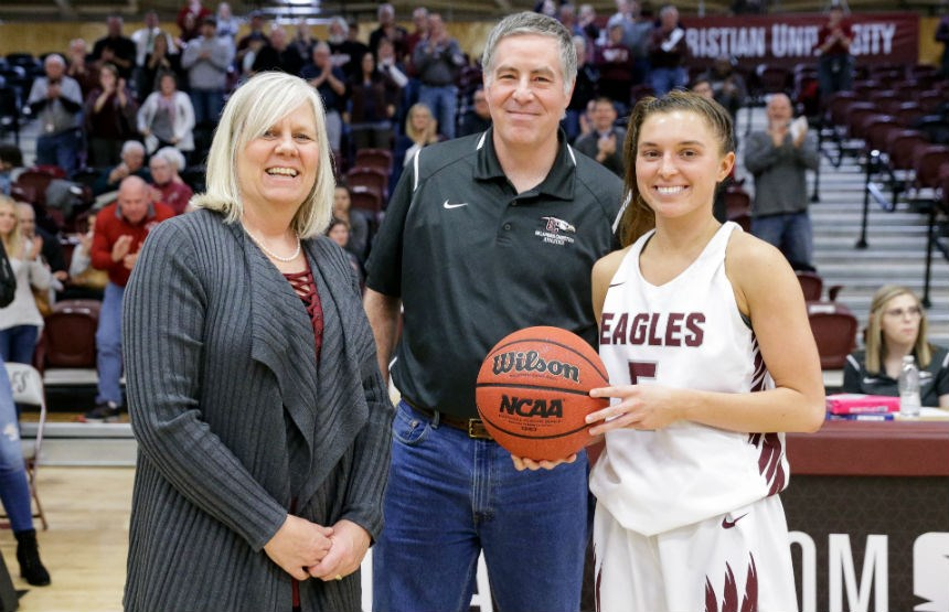 Murray Evans, center, with Oklahoma Christian women's basketball coach Stephanie Findley and player Addy Clift.