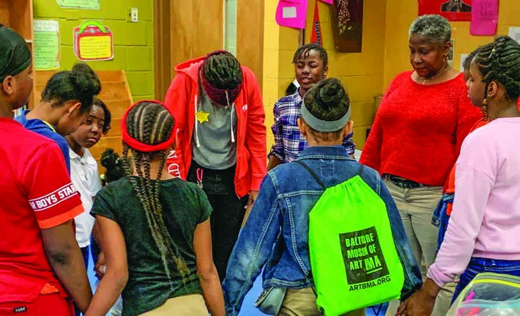 In Sandtown, children pray before a meal sponsored by a newly planted church.