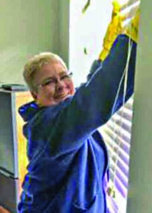 Marsha Clark cleans windows in Mount Dora.