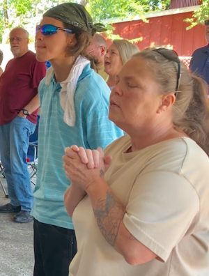 Church members worshipped in the parking lot just days after a fire destroyed their building.