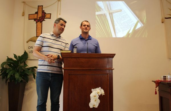 "Brady Ross, right, preaches at the Kuslanova Church of Christ in Zagreb, Croatia, as Kristijan ""Tino"" Jovanovic, left, translates."
