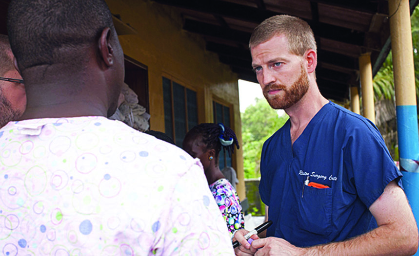 Dr. Kent Brantly sees a patient in Liberia before contracting Ebola in July 2014.