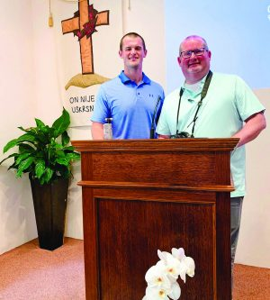 Brady Ross and his father, Bobby Ross Jr., on a recent Sunday at the Kuslanova Church of Christ in Zagreb, Croatia.