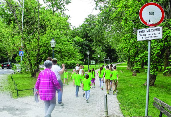 Children and volunteers visit a park during Champs Camp in Zagreb. The weeklong camp has expanded to two locations since its launch nearly a decade ago.