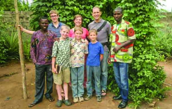 A young Koonce family visits with church members in Tabligbo, Togo.