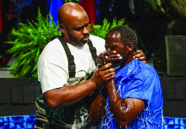 Vallo Cross Jr. from the Forest Hill Church of Christ in Texas baptizes a new brother into Christ at the Crusade for Christ in Fort Worth, Texas.