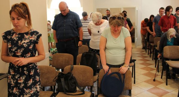 Worshipers pray during the Sunday assembly of the Kuslanova Church of Christ in Zagreb, Croatia.