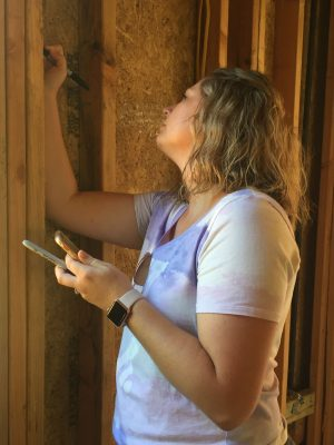 Amy Andrews, a friend from church, writes a favorite Scripture on the studs in what will soon be the kitchen.