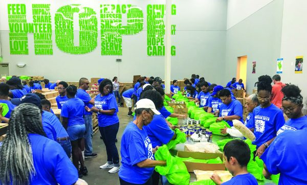 """Volunteers from Churches of Christ work to bring """"hope"""" to Houston's hungry."""