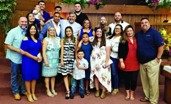 Monica Moreno, third from left at the front, poses with her extended family at the Montwood Church of Christ. The picture was taken on Father's Day.