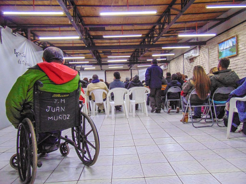 Christians line the walls for Sunday evening worship with Los Nogales Church of Christ in the South American capital of Santiago, Chile. Nearly a quarter of those in attendance are immigrants and refugees from Venezuela.