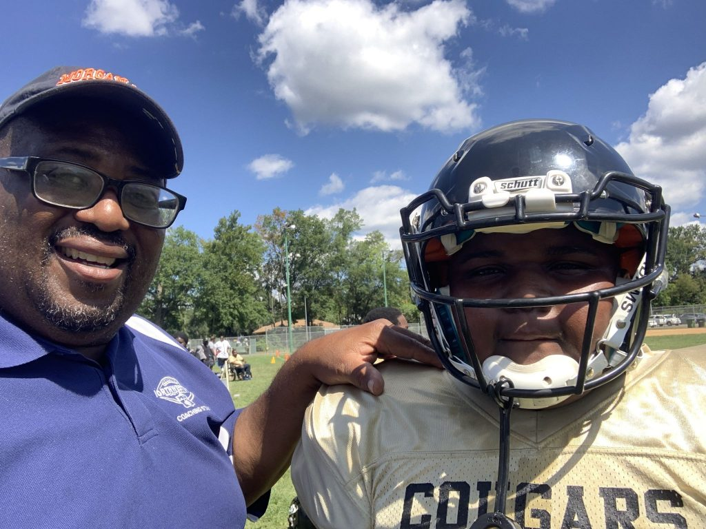 Hamil R. Harris with his son after a recent football game.