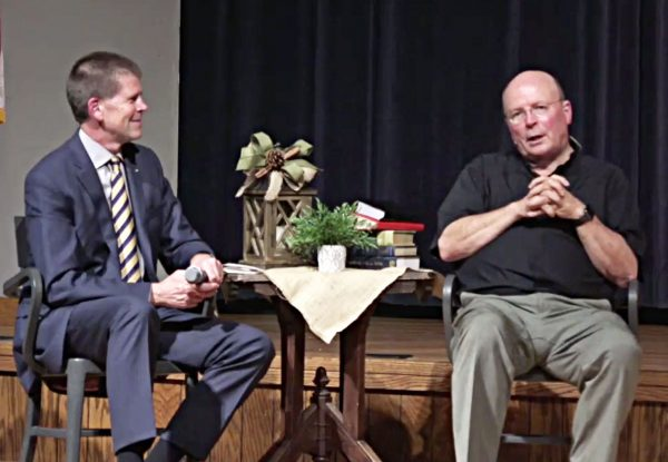 John deSteiguer, president of Oklahoma Christian University, speaks to theologian and author Scot McKnight in the university's Baugh Auditorium.