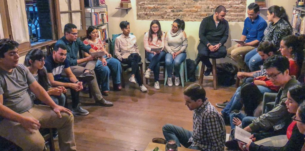 Members of the Redeemer Church of Christ and Venezuelan visitors sing during a devo.