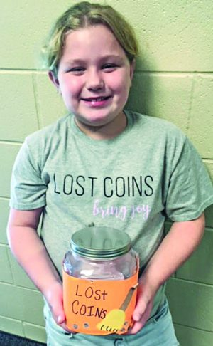 Carter Estep, 9, collects lost coins to benefit poor children.