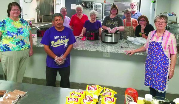 Church members prepare a weekly lunch for high school students in Midland, Texas.