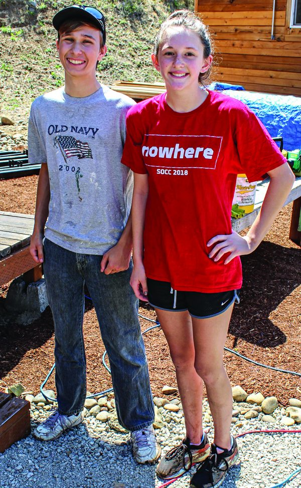 Lucas Ivey, 16, and Naomi Johnson, 13, from the West Main Church of Christ in Medford, Ore., work at Agape Village.
