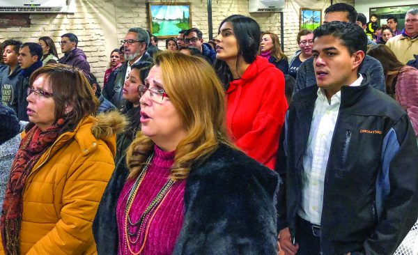 Chileans and Venezuelans worship side by side at Los Nogales Church of Christ.