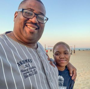 Hamil R. Harris and his daughter Alana enjoy time at a Maryland beach.