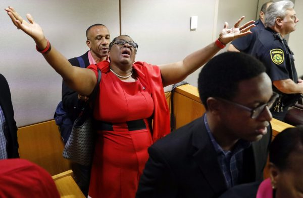 Botham Jean's mother, Allison Jean, rejoices in the courtroom after fired Dallas police officer Amber Guyger was found guilty of murdering her son.