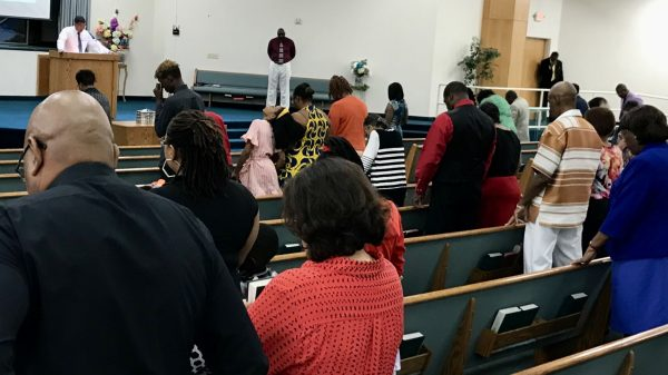 North Las Vegas Church of Christ members stand as they pray.