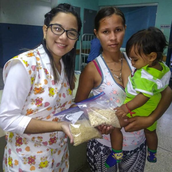 In Venezuela, a mother receives desperately needed vitamins and food for her infant.