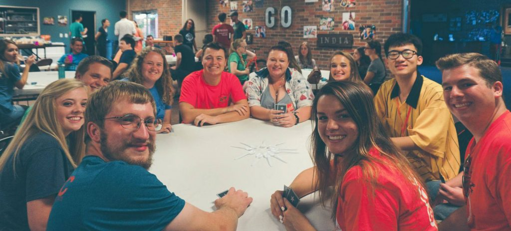 A group of students at the University Center play a game of Spoons.