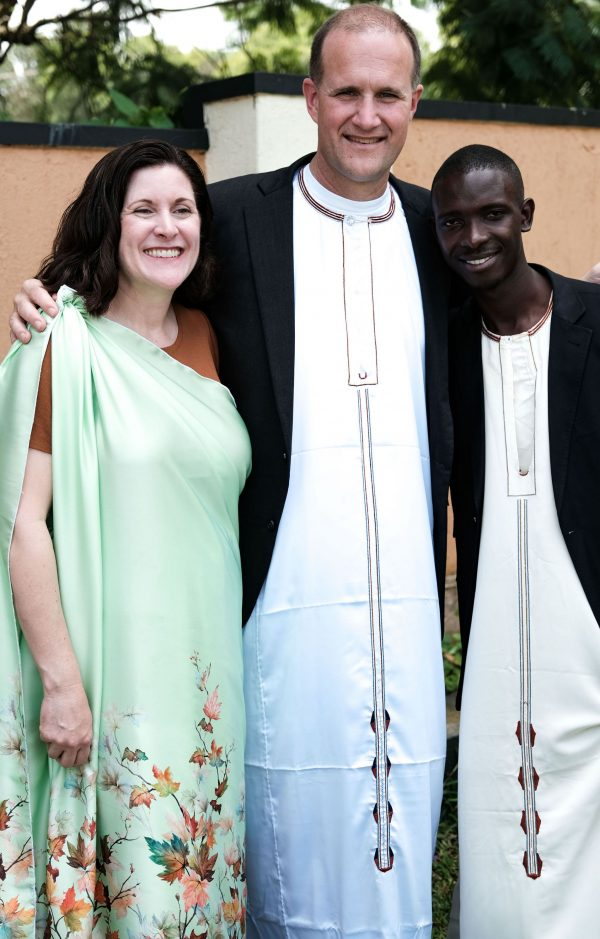 Jim and Joline Gash wear Ugandan attire as they join Tumusiime Henry at his wedding.