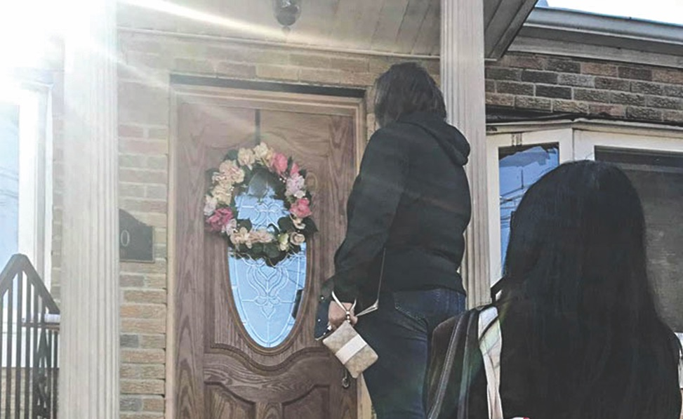 Members of the Long Island Church of Christ in New York knock on a door in their neighborhood during the first Brotherhood-Wide Door Knocking Day.