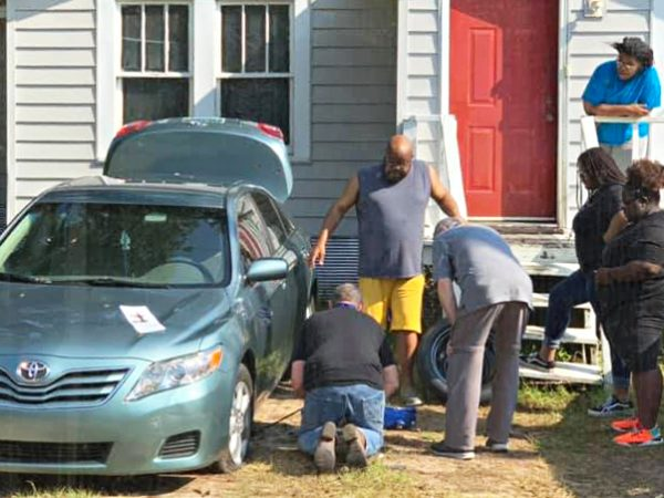 """""""We stopped to visit this man and his family. He was trying to change a flat tire. He was having difficulties since he just got our of the hospital. So, what do we do? We help those that are in need."""" — Wesley Garland, Central Church of Christ, Saraland, Ala."""