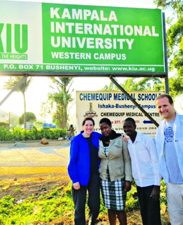 Jim and Joline Gash with Tumusiime Henry and his wife at Henry's medical school.
