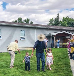 A father leads kids to the after-church carnival in Great Falls.