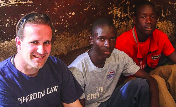 Jim Gash, Tumusiime Henry and Henry's brother Joseph at the Ihungu juvenile prison in 2010.