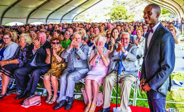 The crowd gives Tumusiime Henry a warm welcome at the inauguration of Jim Gash as the eighth president of Pepperdine University in Malibu, Calif.