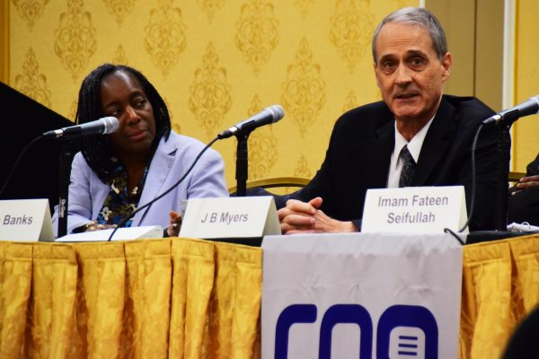 J.B. Myers, right, elder and minister for the Bright Angel Church of Christ in Las Vegas, speaks during a Religion News Association panel moderated by Adelle M. Banks of Religion News Service.