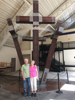 Darrell and Anita Price stand in front of the four-cross sculpture that their son, Aaron Price, created to be displayed at Lubbock Christian University in Texas.