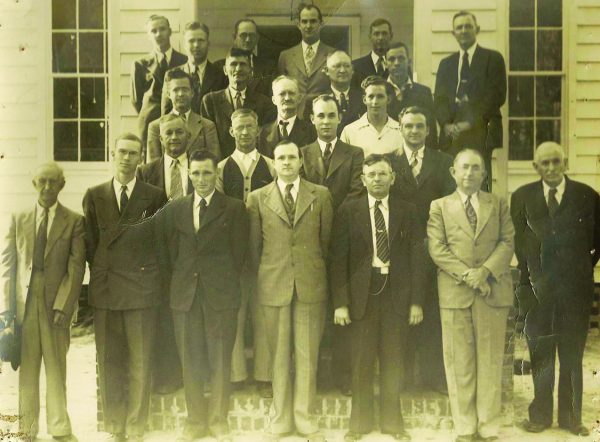 In the 1940s, preachers gather for a meeting at a previous location of the Oak Grove Church of Christ in Rincon, Ga.