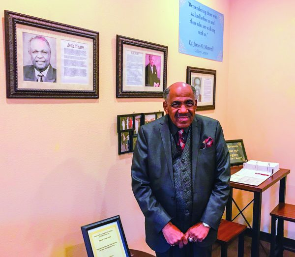 Hours before a celebration of Jack Evans Jr.'s life, longtime Southwestern vice president James O. Maxwell visits a special room at the college that pays tribute to pioneer African American preachers, including Evans.