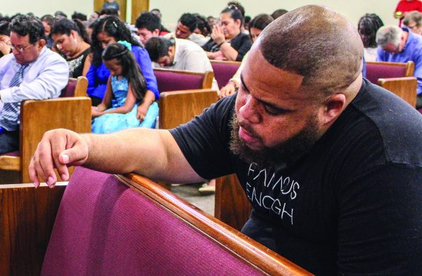 Vince Ford, senior minister for the Genessee Avenue Church of Christ in Columbus, Ohio, prays during the areawide assembly at Northland.