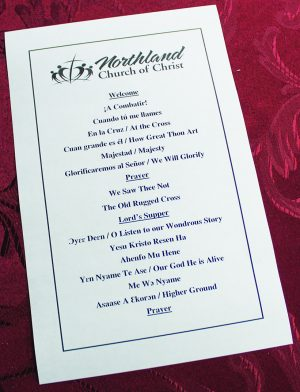 A worship program shows hymn selections in three languages.