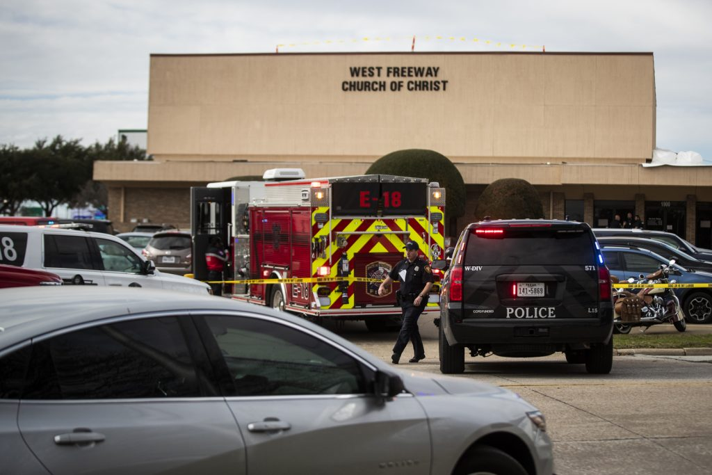 Police and fire departments surround the scene of Sunday's shooting at the West Freeway Church of Christ in White Settlement, Texas.