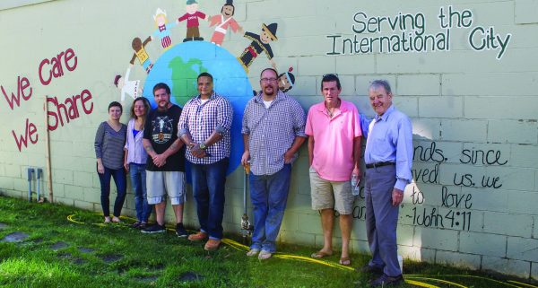 Lisa Moxley, Felicia Ortner, Neil Franklin, Joshua Pryor, Matt Raines, Bill Hurley and Jim Darcy gather outside We Care We Share's food and clothing warehouse.