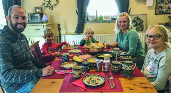 At the countryside farmhouse in Starše, Slovenia, the Lovse family sits down for Saturday morning breakfast. Their daughter, Eva, speaks fluent English.