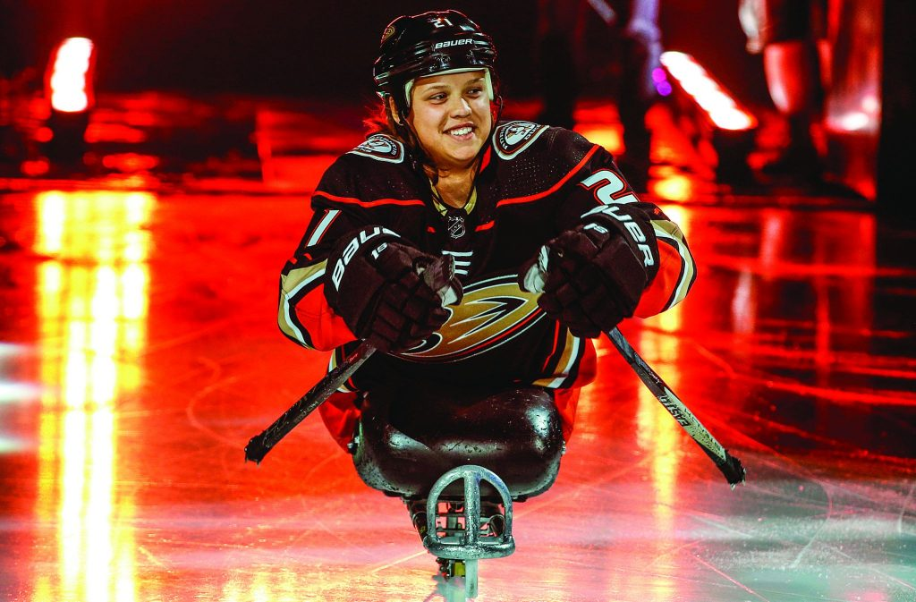 Lera Doederlein, a member of the North County Church of Christ in Escondido, Calif., takes the ice to start a National Hockey League game between the Anaheim Ducks and the Arizona Coyotes.