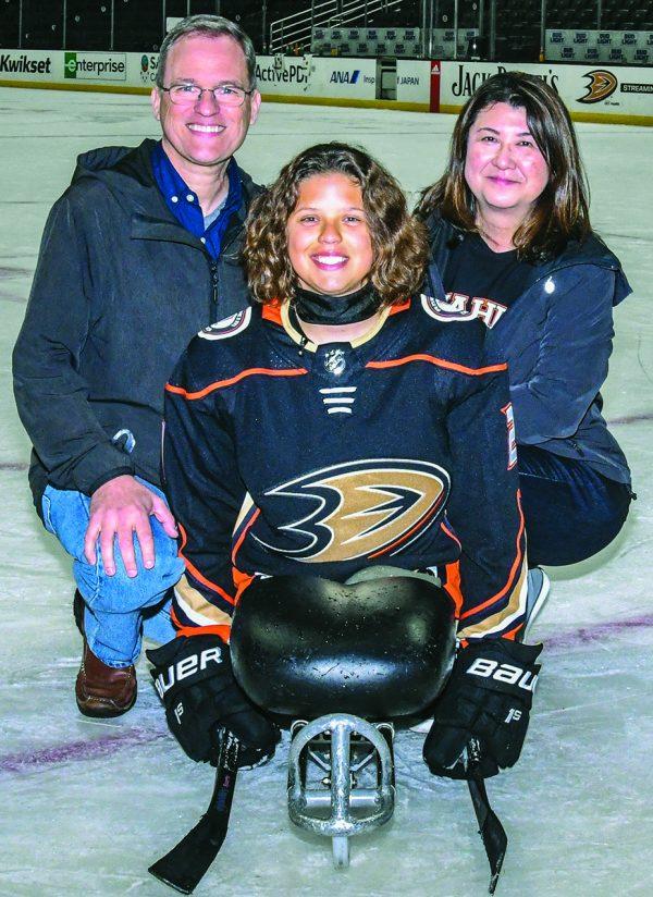 Lera Doederlein on the ice with her parents, David and Fami Doederlein.