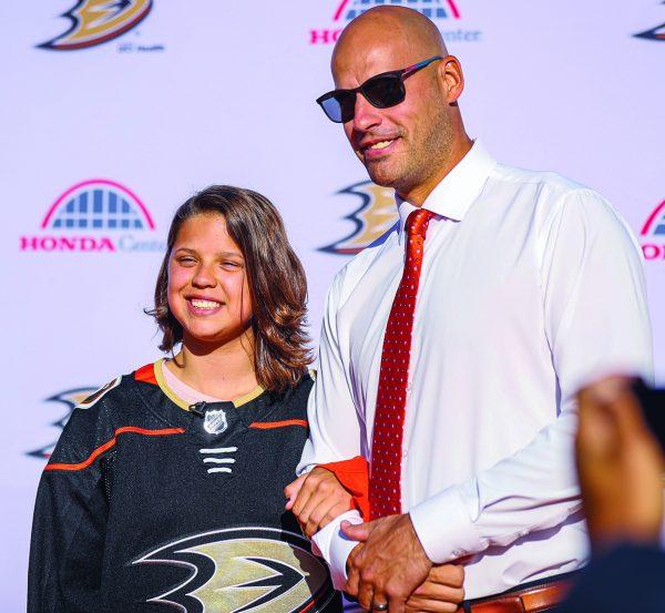 Lera Doederlein poses with Anaheim Ducks team captain Ryan Getzlaf.