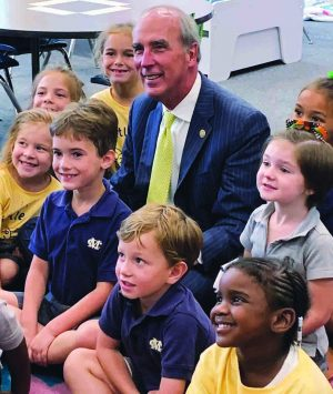 Sandy Stimpson, mayor of Mobile, Ala., joins students in one of the new elementary classrooms at Mobile Christian School.