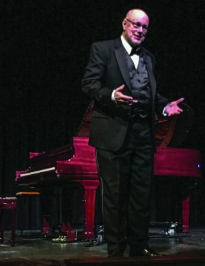 Gordon Bauer talks to the crowd during his recent benefit concert in Parker, Colo.